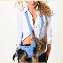 "Puppoose - the ""ergonomically designed, natural way to carry your pet...its hands-free convenience allows more quality time together!"" What more can be said?"
