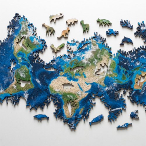 Nervous System Earth Puzzle looks incredible.  It is based on an icosahedral map projection and has the topology of a sphere. This means it has no edges, no North and South, and no fixed shape. And it has 16 figure pieces shaped like indigenous animals!