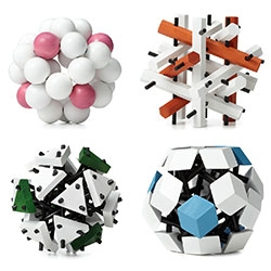 """Geometric Wood Puzzles! """"Once you've completed the Atom, the Molecule poses the next challenge, and then the Particle will stump you. Up for the ultimate challenge? You can tackle the Cell."""""""