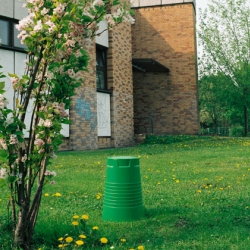 Stool Qoffee a gigantic plastic cup manufactured by Artificial and designed in 1999 by Rainer Spehl.  Qoffee can be used a stool but it can also be used as waste paper basket, container or even as a flower pot.