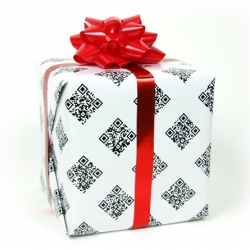 QRapping Paper  - Wrapping presents in this paper will sure to bring joy to anyone with a smartphone. It comes with 2 sheets and has over 50 holiday videos you can scan with your phone and watch.