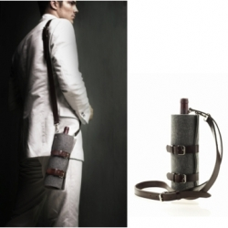 i kind of like the idea of a quiver of wine.  an easy way to carry a bottle to a picnic from graf & lantz.
