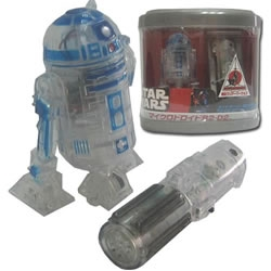 The Japanese toy manufacturer Tomy has released an updated transparent plastic version of their popular radio-controlled R2-D2 mini action figure.