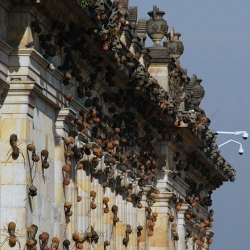 Rafael Gómezbarros 'Casa Tomada' installations showing huge ants on buildings all over the world.