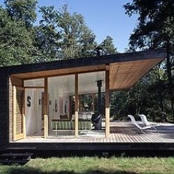Gorgeous little summer cabin in the woods of Asserbo in Denmark, by Christensen & Co.