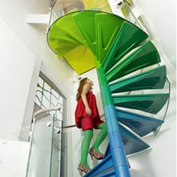 The Rainbow House by Ab Rogers Design in collaboration with DA.Studio has a rainbow staircase and a slide!