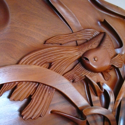Wonderful motion in this wall mounted piece by Robert Howard. Hand-carved in solid-block Honduras mahogany.