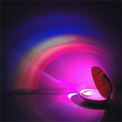 This Rainbow Stone bounces colored LEDs off of a curved mirror to produce an indoor rainbow.