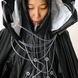 Raincatch by Hyeona Yang and Joshua Noble is a jacket that collects rainwater, purifies it, then stores it. The collar collects the water and with a charcoal purification system turns it into drinking water.