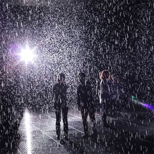 """Rent-Your-Own Rain Rooms Become Big Business in China"" at Creators. Random International's  installation, Rain Room is being copied for events in China."