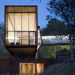 "American architect Randy Brown has designed this ""Lab"" house for his family in Omaha - Nebraska. A rusted steel and wooden house with complex and rich volumetry."