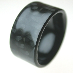 carbon fiber rings, how cool. lots of cool and unusual rings and jewelry on this site. my new fave site for lurking [Editor's Note: also seen as #378]