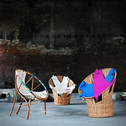 Armchairs, designed by Anna Wołowska, are made of natural materials: wicker and 100% wool, natural felt in cooperation with the local wickermen. Project aims to support the evanescent wicker craft in Poland.