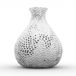 A sculptural vase by Nervous System generated by reaction diffusion, a process which simulates how chemicals diffusing across a surface react with one another to produce stable patterns.
