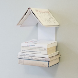 WIS Design had designed Readers' Nest, a simple but ingenious little shelf for all book lovers. Simply place the book up side down on top of the shelf, and you will easily find the page where you stopped reading. For both regular and pocket books.