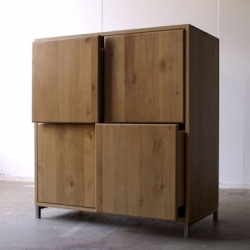 Oooms Studio designed this piece to have at least one drawer that will always stay slightly open while the other drawers are closed. In addition, the way to open a drawer is to hit or kick the one next to it.