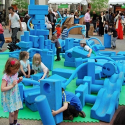 Kids -- future urban planners? -- play with 'city building blocks' at the New Museum Education Department and Rockwell Group's Imagination Playground during the Festival of Ideas in NYC.