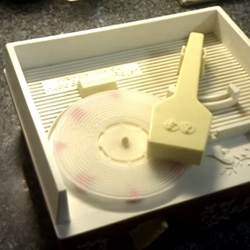 "This 3D printed record (for Fisher-Price clockwork record player) plays Portal's ""Still Alive"" ~ made with Processing, printed at Shapeways - video proof it works!"