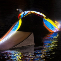 Motion to Light Wakeboarding by Snap!Orlando and light painter Patrick Rochon was created for the Red Bull Illume 2013 photography contest. Mike Dowdy, Adam Errington, and Dallas Friday strap lights to their wakeboards and create an amazing effect.