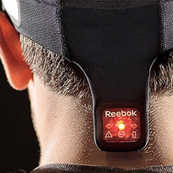 "Reebok's Checklight is a cap that ""alerts athetes, coaches, athletic trainers and parents to the severity of impacts."""