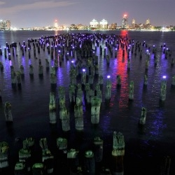The Windmill Factory installed 217 solarpowered LED lights on a decaying pier in NYC's Hudson River for the eco-art installation 'Reflecting the Stars.'