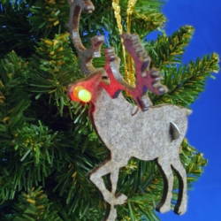 Geek is chic when it comes to these DIY Holiday Felt Ornaments. These ornaments are made from laser cut industrial felt and require you to sew (yes, sew!) the LED circuit using conductive thread!