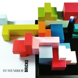 Bricks by Remember Products is a game, an object, a puzzle, a sculpture, artwork, a building set, a model, simply ingenious. For young and old and tall and small.  Bricks are eighteen handmade colored massive beech wood bricks.