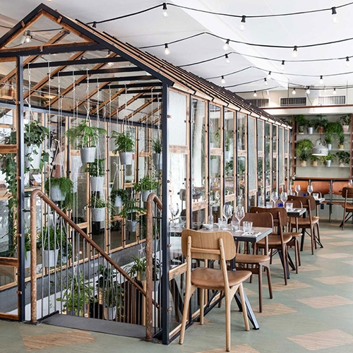Väkst Restaurant in Copenhagen - inside the Hotel SP34 looks stunning! Beautiful, surprising greenhouse inside filled with hanging pots!