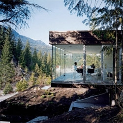 Canadian architects Studio NminusOne designed a house for a professional snowboarder, achieving an interesting house, integrated with the landscape and framing the amazing views over the woods.