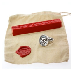 Digby & Iona launches his Signet Collection with the diamond ring, charm, and necklace. The ring is also a working wax seal for your personal correspondence and comes with one stick of red J.Herbin sealing wax.