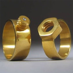Kiley Granberg has designed a nut and bolt wedding ring. The diamond is on the mens ring, but when screwed the it sits on the womens finger.