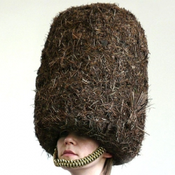 "A woodsy take on the Buckingham Palace Guards' iconic bearskin hat by designer Ritta Ikonen, one of the contributors to ""Hat-itecture,"" a exhibition that combines architecture and hats."