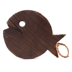 Fish shaped wooden trivet made from smoked Kiri wood