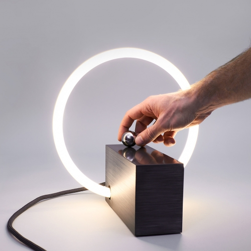 L3 is a minimal desk lamp that renounces a conventional switch – instead it is controlled by moving a metal sphere between two magnetic fields.