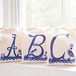 Celebrated British artist and paper-cut genius Rob Ryan has created a beautiful collection of initials in this collaboration with Alphabet Bags.