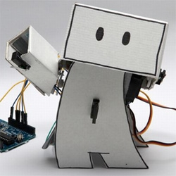 """Ken Lim's """"Guardian Robot,"""" which will keep an eye on your Twitter feed for happy or sad messages from your friends, raising its arm in triumph or lowering its head sulkily."""