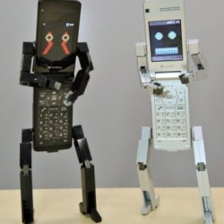 "Japanese cellphone robot. If the user calls a particular person many times, a text phrase such as ""You're calling her often these days, aren't you?"" comes out of the face's mouth."