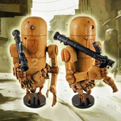 Ashley Wood, who's my new comic book hero for putting new life into Tank Girl, is tempting me with these amazing limited edition robots from the Zombie vs Robots series