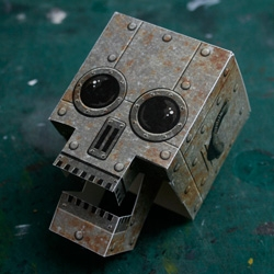 Free downloadable steampunk-style robot update to the classic Skull-A-Day papercraft skull with moving jaw.