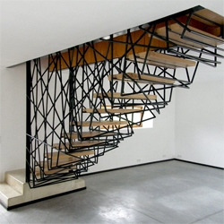 The staircase in this French home is encased in a mesh of woven steel. Villa la Roche designed by archiplein.