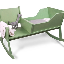 Rockid by Ontwerpduo, a rocking chair and cradle in one. Softly swinging the rocking chair while reading a book or singing a lullaby. When the baby outgrows the cradle, it is possible to reconstruct the rockid into a rocking chair.