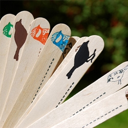 Kim Jenkin's has the most adorable set of hand-foiled popsicle sticks to label your plants!