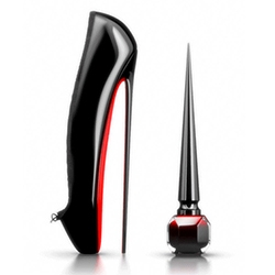 Christian Louboutin Rouge Nail Lacquer. A true objet d'art of a dramatic 8-inch height inspired by the tallest heel Christian Louboutin ever created- the Ballerina Ultima. It is packaged in a weighted ombré glass bottle with a special triangular brush.