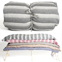 "Hedgehouse ""Throw Beds"" ~  a down and fiber filled cushion that's the same size as a twin bed, weighing only 4lbs. The cushion is covered in a removable and washable linen or cotton cover and comes rolled up in a matching bag with a shoulder strap"