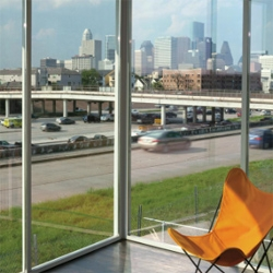 Architect Ronnie Self's home is situated overlooking a busy Houston freeway.