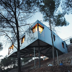 ADD+ designed this house over a slope, with a complex roof that is actually a mini golf course.