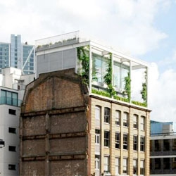 Beautiful and unexpected Roof Garden Apartment above an old brick warehouse in Shoreditch, London.