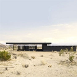 Rosa Muerta is a vacation rental house designed by Robert Stone. With careful climate strategy, the house offers a comfortable interior in the middle of the desert, and great details such as the steel roses.