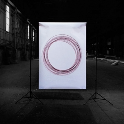 Rotodrawings - a large rotating device, hung from the ceiling generates random-hits art