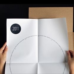 The simple cardboard packaging of this calendar is a refreshing take on traditional office wall planners. The calendar itself is round in shape defying normal expectations.